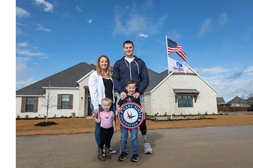 captain murphy and family outside new home